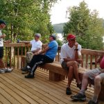 A group enjoying the deck at Farr Island / Un groupe profitant du grand patio à l'île Farr sur le lac Temiskaming